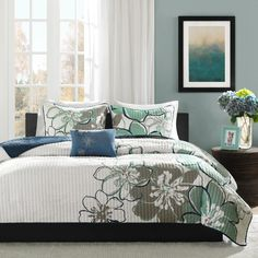 Renovate your decor with this twin quilt set. With its contemporary floral design, this four-piece quilt set will bring a touch of updated charm to any bedroom. The microfiber blend construction of this set ensures comfort and durability. Coverlet Bedding, Comforter Sets, Bedspreads, White Coverlet, Teen Girl Bedding, How To Clean Pillows, Shabby, Bedding Sets Online, Bed Duvet Covers