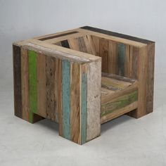 Pallet chair! Just cover place a sofa seat on it and sand it down. Also maybe a possible covering for the chair.