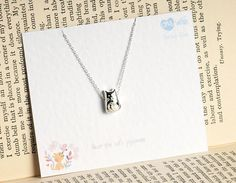 """your'e the cats pyjamas""Beautiful, delicate sterling silver cat charm necklace The charm is hung on a delicate sterling silver trace chain Designed with a smile and love in mind A perfect gift of love and sentiment for your loved one to let them know you are there All One Wish pieces come on a sentiment quote card to compliment the piece and are packaged in the One Wish beautiful card envelopesSterling Silver10 x 5mm / Necklace 41cm"