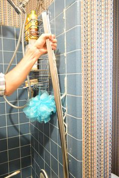 How to remove sliding shower doors and replace with curtain rod | Young House Love