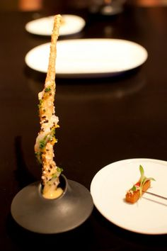 Served on a pin. Courtesy of Alinea.