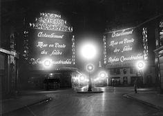 The deserted illuminated street at night in Paris. 1929