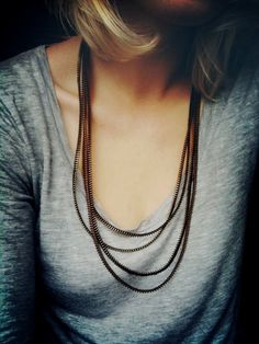 gray tee + layered necklaces.
