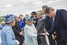 Engagement number one: The Queen shakes hands with Prime Minister David Cameron in Runnyme...