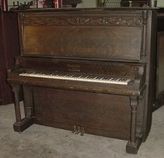 """Piano restoration.  This is very similar to the one I have.  Mine does not have the carving on the face panel, but other than a shaving of 1/4"""" off of one side because the former owner needed it to fit into a smaller space, mine looks to be in better shape.  This company did not last very long, but was based in Chicago.  My piano is a 1907."""