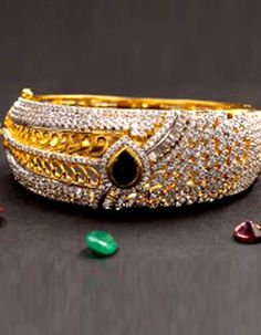 #Bangles, #Bracelets & #Kadas - Gold Plated Bangle With Gemstone And American Diamonds Costs Rs. 4,700. #Jewellery. BUY it here: http://www.artisangilt.com/jewellery/bangles-bracelets-kadas/gold-plated-bangle-with-gemstone-and-american-diamonds.html?ref=pin