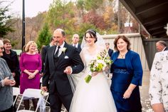 The gorgeous bride entered the ceremony with both of her parents. ::Ashley + Daniel's striking fall wedding at the Roswell River Landing in Georgia:: #georgiawedding #wedding #photography #ceremony