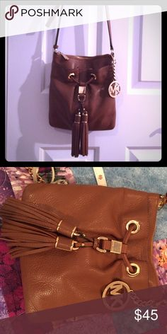 Brown Michael Kors Cross body Matches with almost everything.. either wear it for an everyday bag or evening bag. Worn multiple times but still in good shape. Has a lot of room and pockets. Michael Kors Bags Crossbody Bags