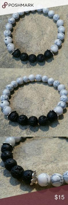 """White Magnesite & Black Lava 8mm Stone Bracelet New, beautifully handcrafted in Florida, genuine 8mm smoothed volcanic basalt lava & marbled magnesite stone bracelet with 2 silver tone spacer discs. Perfect for chakra, spiritual, health meditation work, as aromatherapy essential oil diffuser,enjoying it's beauty alone, or layering with my boho other stacker bracelets. Thick high quality stretch cord, inside circumference 6.75"""". Custom sizing available  Thank you for visiting my closet…"""