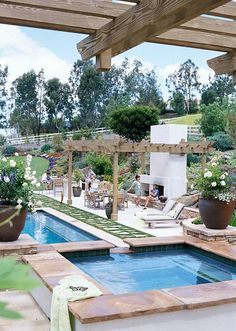 Outdoor fireplace, pergola, hot tub and pool...