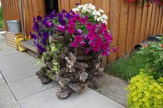 Stacked branches to hide a plastic container, love it!