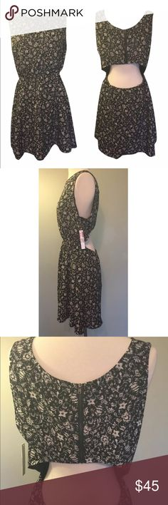 """New Aqua floral black cutout dress size large Beautiful summer dress with a floral print. Black and ivory Sleeveless Cutout detail in back Zips on top half Elastic waist band 100% polyester Measurements: Bust:  19.5"""" / Total Length: 36.5""""  / Waist: 13""""  / Hips: 22""""  Condition: New with tags!  Retails $118   Comes from a smoke free home.  Stock #: AMH-C258 Aqua Dresses Midi"""