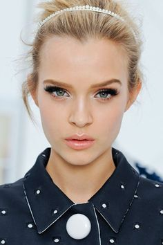 chanel-Love the whole look-- fresh, clean face, lush lashes, glossy lips, hair pulled back w/ head band, whispys flying out...