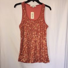 Forever21 sequin tank top ✨NEW✨ I have a NWT forever 21 sequin tank top. It has a beautiful coral/ orange color with sequins all over it. It's Small and its stretchy material. Forever 21 Tops Tank Tops