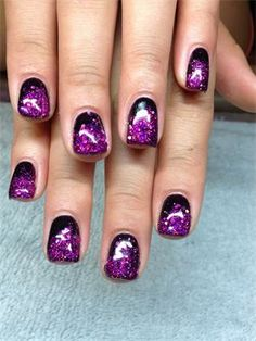Love these purple and black colored acrylic nails!!!