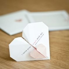 Try this Origami Wedding Invitations - http://www.ikuzoorigami.com/try-this-origami-wedding-invitations/