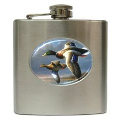 """Flying Ducks Hip Flask Stainless Steel 6 oz 17160684 by Blueskiesplusllc. $27.99. Clear enamel design. 6 oz Stainless steel Hip Flask. Screw top cover with holder. High Quality. The 6 oz stainless steel hip flask measures 3 1/2"""" w x 4 1/4"""" h x 3/4"""" d. It is curved to be comfortable in your back pocket. Comes with a screw top cover with holder so you can't loose it after you open it. The image is covered by crystal clear enamel, for long time protection. This is NOT a cheap sti..."""