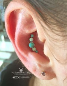 Emily had us pierce her conch, and we are absolutely loving this combination she chose from anatometal​. Turquoise and white opals handset (never any glues or adhesives with anything we sell) in implant grade titanium. Thank you so much, Emily! vaughnbodyartsMonterey, CA