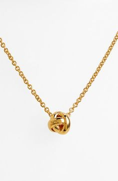 Free shipping and returns on kate spade new york 'dainty sparklers' knot pendant necklace at Nordstrom.com. A beautiful polished knot is strung on the slender gilded chain of this layerable pendant necklace.