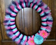 How to make a Tulle Wreath. There are as many ways to decorate a wreath as there are types of ribbons and fabrics! With the arrival of spring, we put together a light and airy wreath using tulle and gerbera daisies! A great DIY craft project that can used Tulle Crafts, Wreath Crafts, Diy Wreath, Mesh Wreaths, Holiday Wreaths, Holiday Crafts, Diy Crafts, Wreath Ideas, Tulle Projects