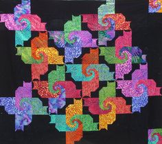 Psycho Cats Pattern by everywitchway on Etsy, look close they are all cats in crazy colors!  quilt
