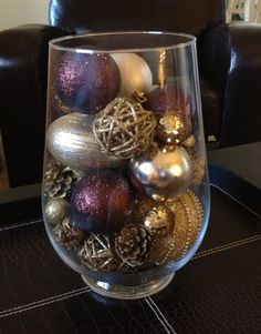 Fill a hurricane vase with ornaments for a simple centerpiece