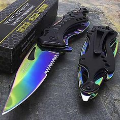 With a black half-serrated blade this beautiful rainbow tactical knife is the perfect stocking stuffer this year. It features a 3 ¼ inch stainless steel blade w