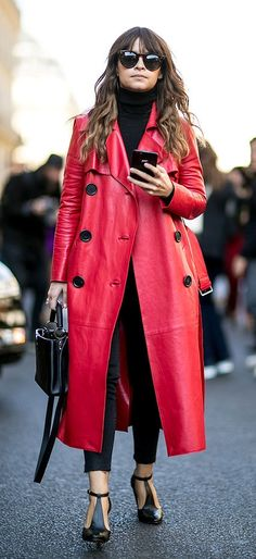 A statement red coat with a black turtleneck sweater and black accessories