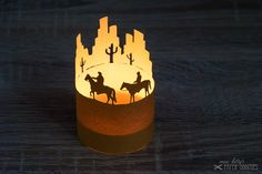 construction paper for a little lantern. wild west scenery with two cowboys.