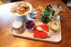 Make little trays to put in the guest bedroom whenever a guest is staying.  This lists a welcoming tray, a bath tray, and a snack tray.  This would be an excuse to have some nice-looking trays around the house