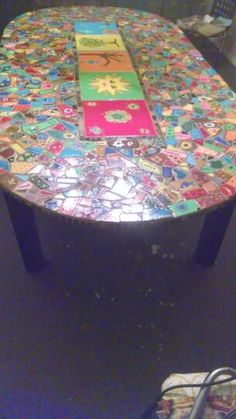 Table I made from left over  bathroom tiles and grout, 4 wood posts and a piece of  plywood