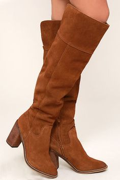 "The Steve Madden Palisade Chestnut Leather Over the Knee Boots are just the thing you need to finish off that '70s inspired outfit! Genuine suede rises from a rounded, oil-rubbed toe (and heel) into a 21"" shaft with a notched collar. Shaft has a 15"" circumference below the knee. 7"" zipper at the instep."