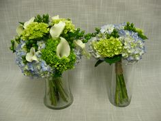 Handtied wedding bouquets of blue hydrangea, lime green hydrangea, white mini calla lilies and green hypericum berries bound with simple twine.
