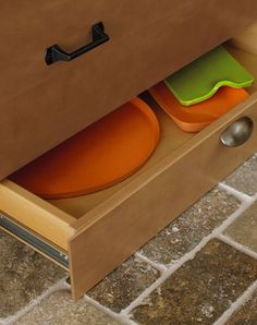 A toekick drawer keeps flat pans, serving trays, and cutting boards out of the way while still providing easy access.
