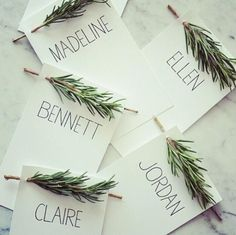 Custom place settings with names of guests and a sprig of evergreen or rosemary. #WriteDudes #WriteOn