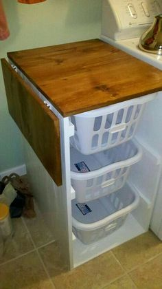 Laundry or Bedroom. Storage & Organization. Triple decker hamper to separate laundry.