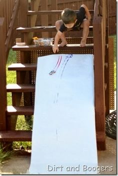 Let it roll!  Paint + cars + ramp= amazing fun for kids!