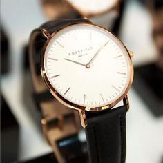 This minimalist watch with interchangeable leather straps is a must for a modern woman.   > www.rosefieldwatches.com