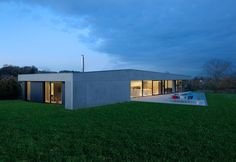 Completed in 2014 in Steinbrunn-le-Bas, France. Images by Alain-Marc Oberlé. The villa is fitted to a bucolic rural land in a small village of eastern France.  The radical and uncompromising project takes place in this site to...