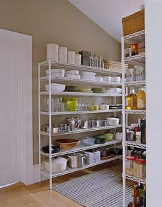 Ina Garten - Chef's Dream Open shelves are stocked with a collection of cake stands and hotel silver. Viking range and hood; Sub-Zero refrigerator; Bosch dishwasher; KitchenAid mixer.