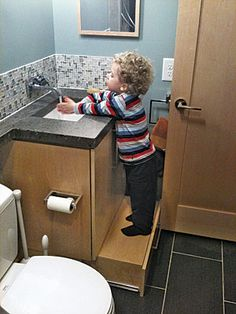 lower bathroom cabinet drawer & a step stool -  it slides out and has a top so your child can use it as a step stool & the top opens up so you can use the drawer as storage.  Brilliant.