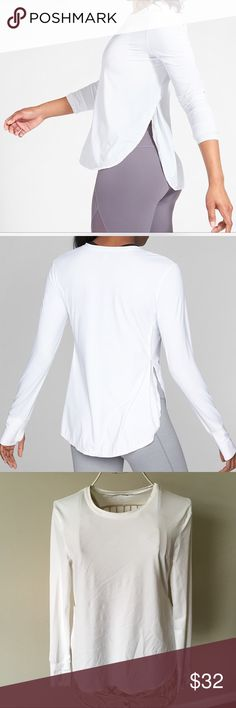 """Athleta Sunlover UPF Long Sleeve Top - M Women's Athleta Sunlover UPF Top!  Great for any outdoor activity or to use as a coverup for your favorite bathing suit! Size M Bright White Semi fitted Lightweight Breathable Thumb holes keeps top in place. UPF 50+ Size tag removed for comfort. Side slits with pretty mesh detail. Measures 18"""" across and 26"""" in length in the front, 27"""" in length in the back. In excellent used condition. From a smoke free ho Athleta Tops Tees - Long Sleeve"""