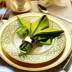 This Fleur De Lis napkin fold makes a dramatic presentation suitable for a formal occasion.