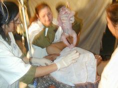 This incredible photo of the a baby being born at the IDF field hospital in India.