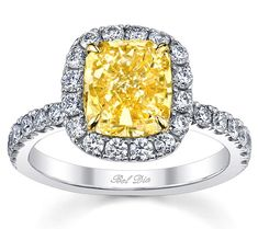 A yellow diamond halo engagement ring setting with white diamonds beautifully shows off this center cushion-cut natural fancy yellow diamond (not included), set in a four-prong yellow gold setting. Sixteen round brilliant cut diamonds encompass the center diamond, making it appear even larger, and 14 diamonds are set French pave down the shank for plenty of sparkle. Select the metal of your choice — 14kt or 18kt white or yellow gold, palladium, or platinum 950. This ring is a deBebians…