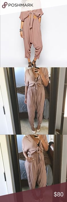 """Free People """"Dune"""" Jumpsuit!! Mocha colored harem style jumpsuit in a breathable crepe material, featuring  an elastic waist, tie front, cuffed hem and functioning side pockets. This is a reposh for me. After having three children, I just can't make it work😔😔! NWT. PRICE FIRM! Runs Big. Free People Pants Jumpsuits & Rompers"""