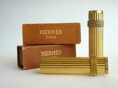 Gold-plated brass Hermès lighters, both c. 1950.