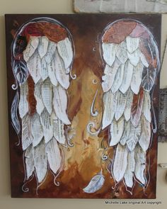 16 x 20 acrylic and mixed media painting.  I used antique music and books and current books based on the law of attraction  These beautiful wings