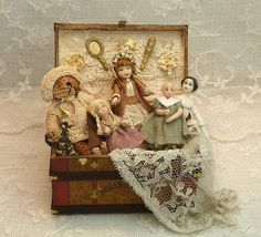 Miniature trunk with teddy, dolls, lace...