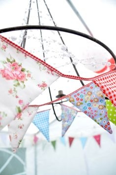 Pretty floral and check pennants hung round wire lamp shade cottage style